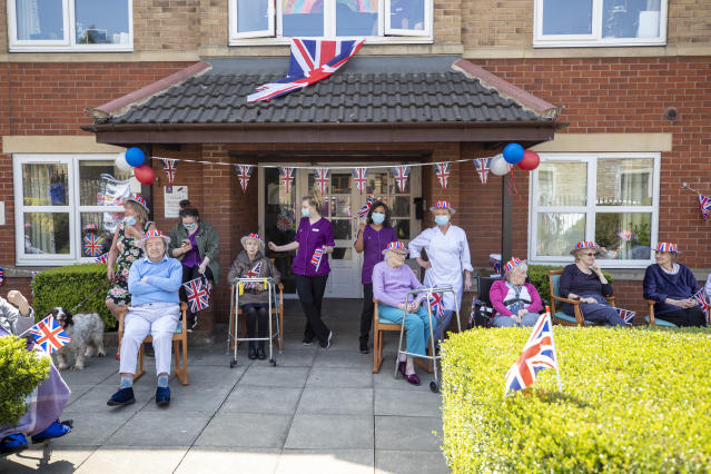 Staff and residents at Anchor's Millfield care home in, Greater Manchester, celebrate the 75th anniversary of VE Day. Downing Street said today that 5,889 care homes had seen a suspected outbreak of symptomatic or confirmed COVID-19 as of 17 May. (PA Images)
