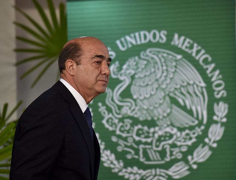 Mexico's Attorney General Jesus Murillo Karam arrives for a press conference at the Attorney General building in Mexico City on October 22, 2014 (AFP Photo/Yuri Cortez)