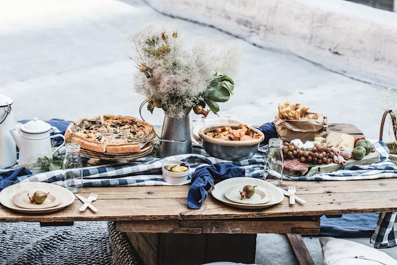wooden table rooftop picnic set up