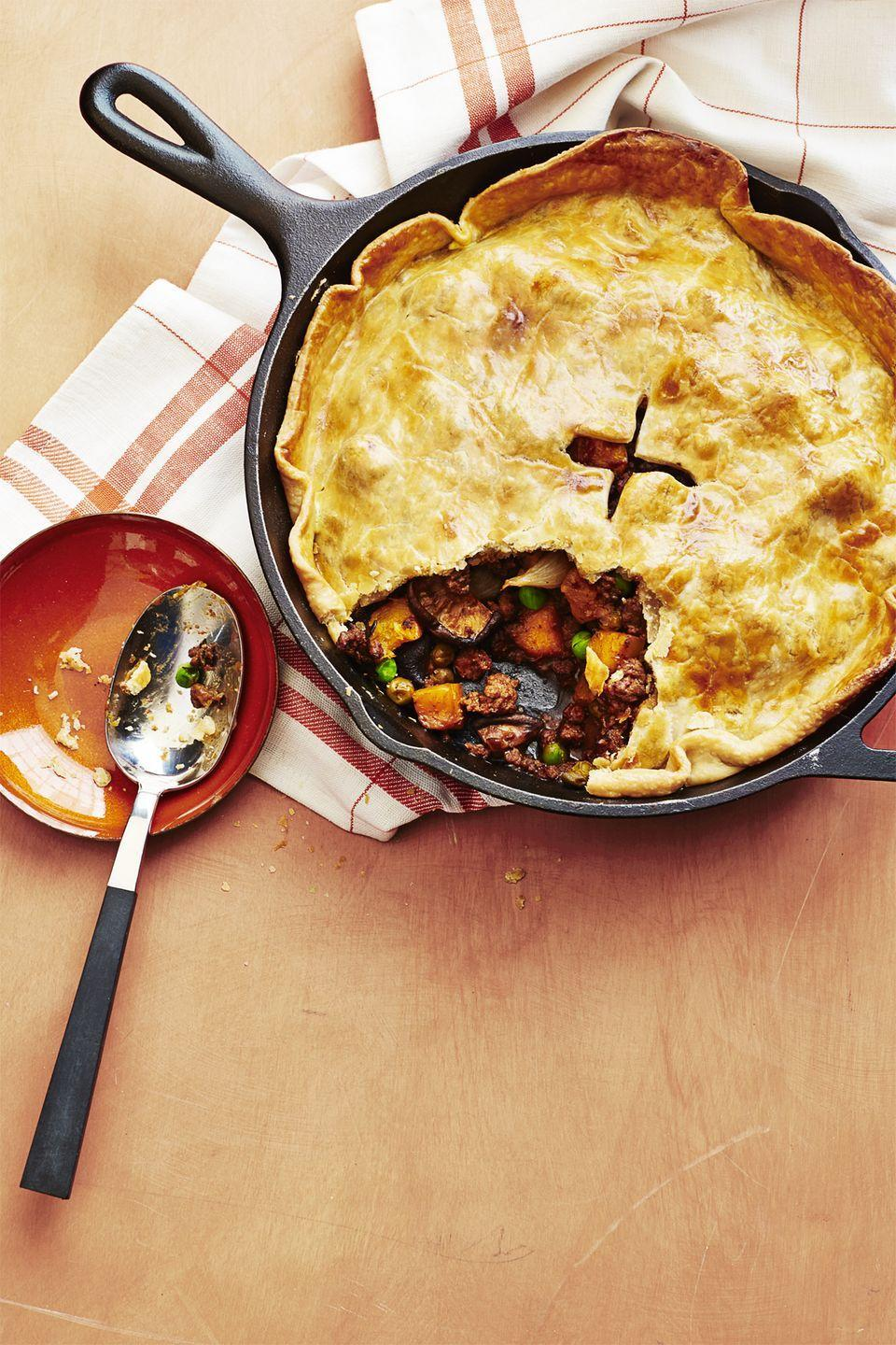"<p>This flavorful one-pan beef pie is easy to make (a store-bought crust helps), but is hearty, and fancy enough to feel special.</p><p><strong><a href=""https://www.countryliving.com/food-drinks/recipes/a34529/beef-stout-skillet-pie-recipe-wdy0914/"" rel=""nofollow noopener"" target=""_blank"" data-ylk=""slk:Get the recipe"" class=""link rapid-noclick-resp"">Get the recipe</a>.</strong></p><p><a class=""link rapid-noclick-resp"" href=""https://www.amazon.com/Lodge-Skillet-Pre-Seasoned-Ready-Stove/dp/B00006JSUA?tag=syn-yahoo-20&ascsubtag=%5Bartid%7C10050.g.34100795%5Bsrc%7Cyahoo-us"" rel=""nofollow noopener"" target=""_blank"" data-ylk=""slk:SHOP CAST IRON SKILLETS"">SHOP CAST IRON SKILLETS</a> </p>"