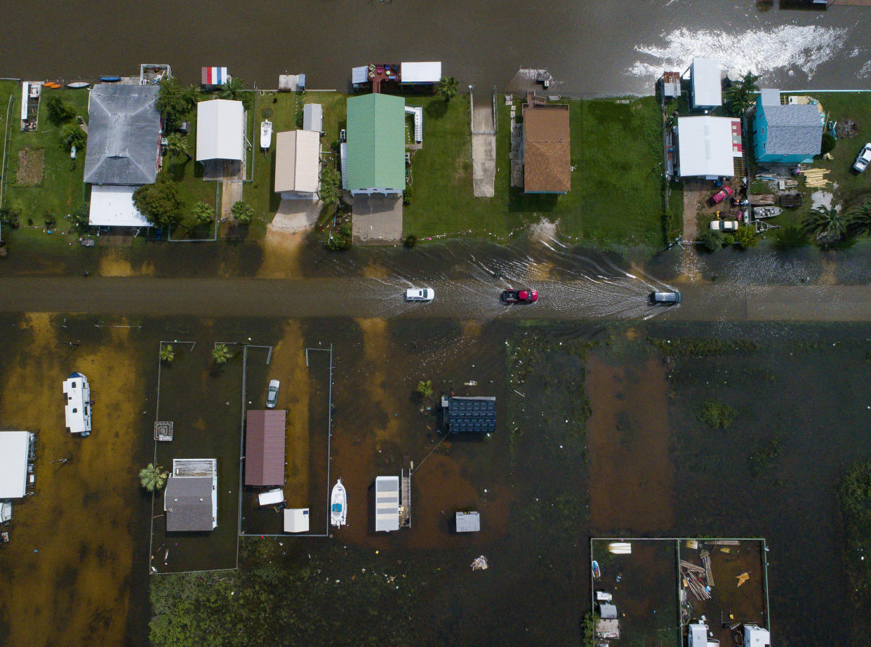 Cars drive on a flooded street in Sargent, Texas, as seen in this aerial photo, Sept. 18, 2019. (Photo: Mark Mulligan/Houston Chronicle via AP)