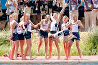WINDSOR, ENGLAND - AUGUST 02: The United States team throw their cox Mary Whipple into the water as they celebrate with their gold medals during the medal ceremony after the Women's Eight final on Day 6 of the London 2012 Olympic Games at Eton Dorney on August 2, 2012 in Windsor, England. (Photo by Jamie Squire/Getty Images)