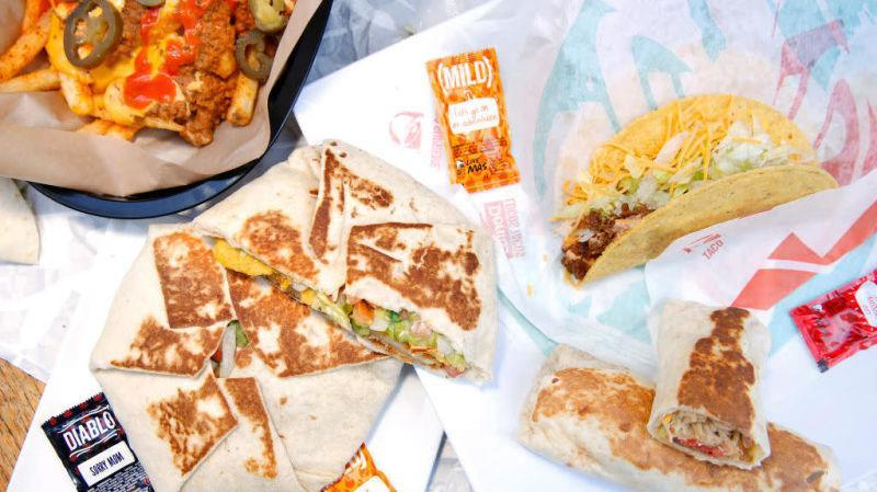 Taco Bell chalupa, tacos and sauces on wrappers