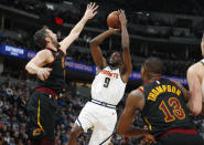 Denver Nuggets forward Jerami Grant, center, goes up for a basket between Cleveland Cavaliers forward Kevin Love, left, and center Tristan Thompson in the first half of an NBA basketball game Saturday, Jan. 11, 2020, in Denver. (AP Photo/David Zalubowski)