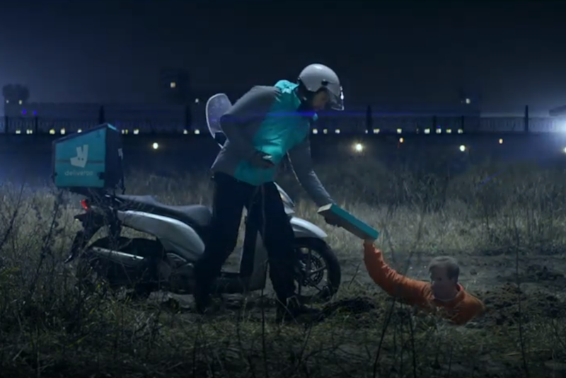 A customer is shown receiving a delivery in a field after apparently tunnelling under-ground to escape from prison: Deliveroo