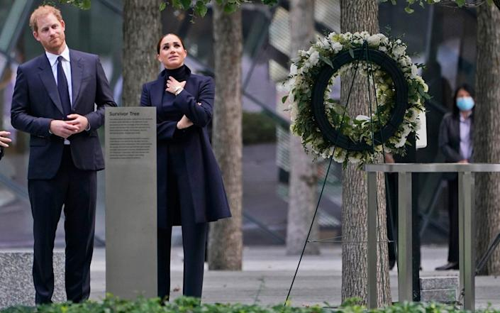 Meghan Markle and Prince Harry pause while getting a tour of the National September 11 Memorial & Museum in New York - AP