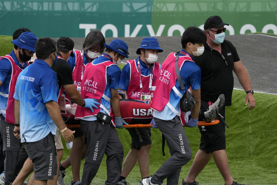 Medics carry away on a stretcher Connor Fields of the United States after he crashed at the first bend in the men's BMX Racing semifinals at the 2020 Summer Olympics, Friday, July 30, 2021, in Tokyo, Japan. (AP Photo/Ben Curtis)