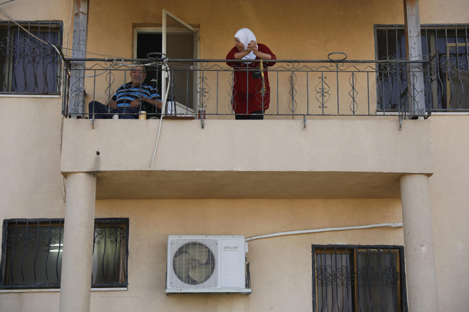 Locals look at Palestinian fugitive Zakaria Zubeidi's hideouts in Umm al-Ghanam, northern Israel, Saturday, Sept. 11, 2021. Following Zubeidi's arrest, police said they have caught four of six Palestinians who broke out of a maximum-security prison early this week. (AP Photo/Ariel Schalit)
