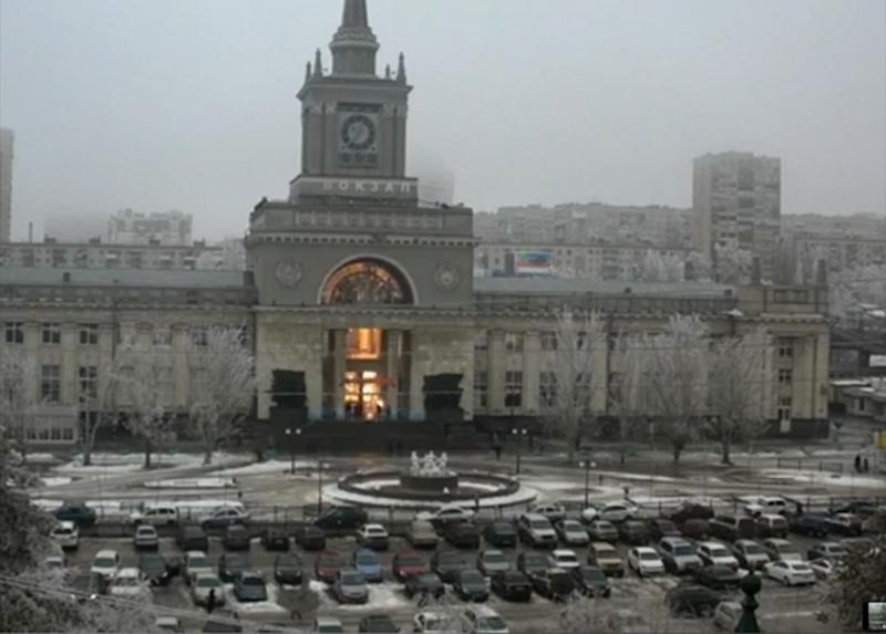 In this photo made by a public camera and made available by the Associated Press Television News the flash of an explosion illuminates the entrance to Volgograd railway station in Volgograd Russia on Sunday, Dec. 29, 2013. More then a dozen people were killed and scores were wounded Sunday by a suicide bomber at a railway station in southern Russia, officials said, heightening concern about terrorism ahead of February's Olympics in the Black Sea resort of Sochi. (AP Photo/ Associated Press Television News)