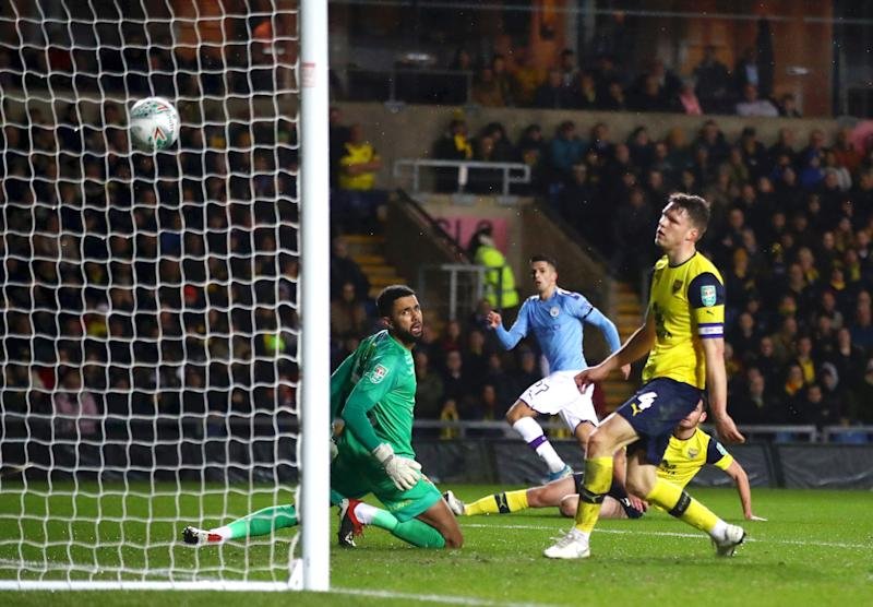 OXFORD, ENGLAND - DECEMBER 18: Joao Cancelo of Manchester City scores his team's first goal during the Carabao Cup Quarter Final match between Oxford United and Manchester City at Kassam Stadium on December 18, 2019 in Oxford, England. (Photo by Julian Finney/Getty Images)