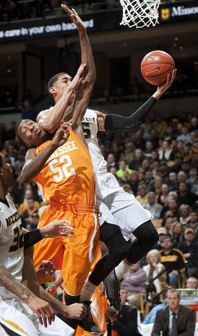 Missouri's Jordan Clarkson, right, is fouled by Tennessee's Jordan McRae as he shoots during the first half of an NCAA college basketball game Saturday, Feb. 15, 2014, in Columbia, Mo. (AP Photo/L.G. Patterson)