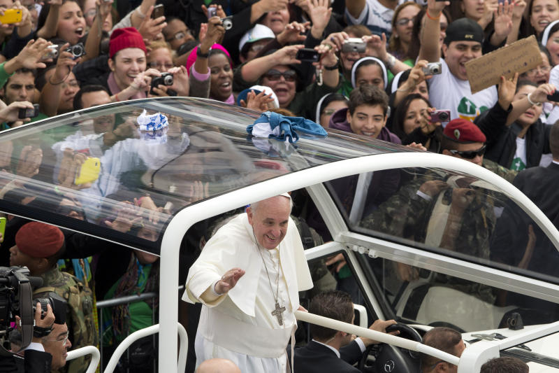 In this July 28, 2013 file photo, Pope Francis waves from his popemobile along the Copacabana beachfront on his way to celebrate the World Youth Day's closing Mass in Rio de Janeiro, Brazil, Sunday, July 28, 2013. Brazilian researchers say the Roman Catholic Church's 3.7 million estimate of the crowd that turned out to see Francis celebrate Mass on Copacabana beach is inflated, if still impressive. One of Brazil's top polling and research firms estimates the crowd at the Mass was at most 1.5 million people. (AP Photo/Victor R. Caivano, File)