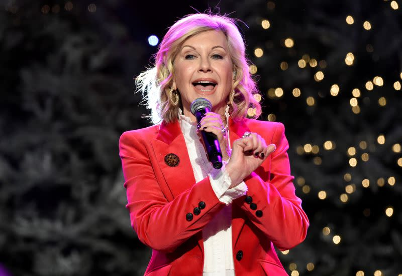 FILE PHOTO: Olivia Newton-John performs before the 85th annual Hollywood Christmas Parade in Los Angeles