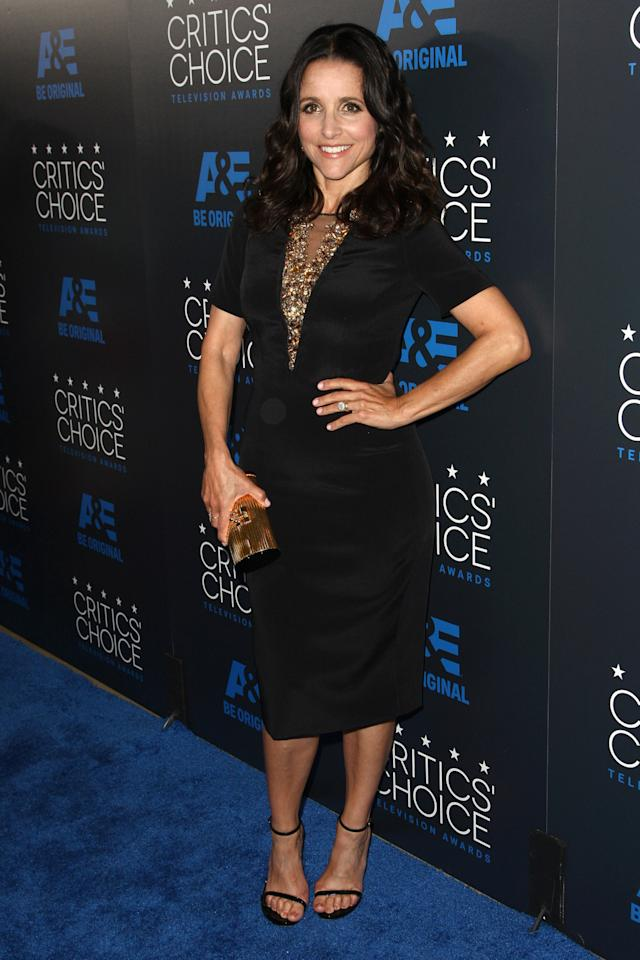 Julia Louis-Dreyfus showed her sexy non-presidential side in a form-fitting sating Carolina Herrera dress with a deep V lace inset.