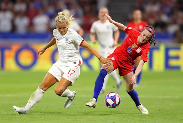 Rose Lavelle of the USA is challenged by Rachel Daly of England during the 2019 FIFA Women's World Cup France Semi Final match between England and USA at Stade de Lyon on July 02, 2019 in Lyon, France. (Photo by Richard Heathcote/Getty Images)