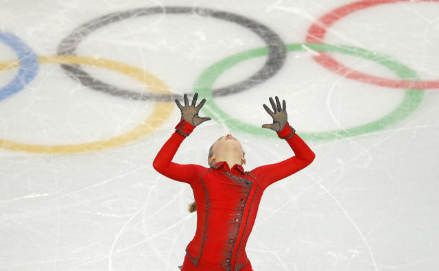 Julia Lipnitskaia of Russia competes in the women's team free skate figure skating competition at the Iceberg Skating Palace during the 2014 Winter Olympics, Sunday, Feb. 9, 2014, in Sochi, Russia. (AP Photo/Vadim Ghirda)