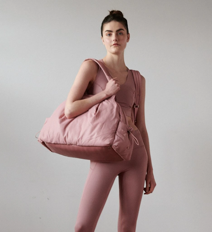 """<h2>Caraa Nimbus Bag</h2><br>This ballet pink weekender is an organizer's dream. It features FOURTEEN total pockets and compartments and is made with a water repellent interior and exterior. <br><br><em>Shop <strong><a href=""""https://caraasport.com/collections/duffels"""" rel=""""nofollow noopener"""" target=""""_blank"""" data-ylk=""""slk:Caraa"""" class=""""link rapid-noclick-resp"""">Caraa</a></strong></em><br><br><strong>caraa</strong> Nimbus Large, $, available at <a href=""""https://go.skimresources.com/?id=30283X879131&url=https%3A%2F%2Fcaraasport.com%2Fcollections%2Fduffels%2Fproducts%2Fnimbus%3Fvariant%3D31783394410576"""" rel=""""nofollow noopener"""" target=""""_blank"""" data-ylk=""""slk:caraa"""" class=""""link rapid-noclick-resp"""">caraa</a>"""
