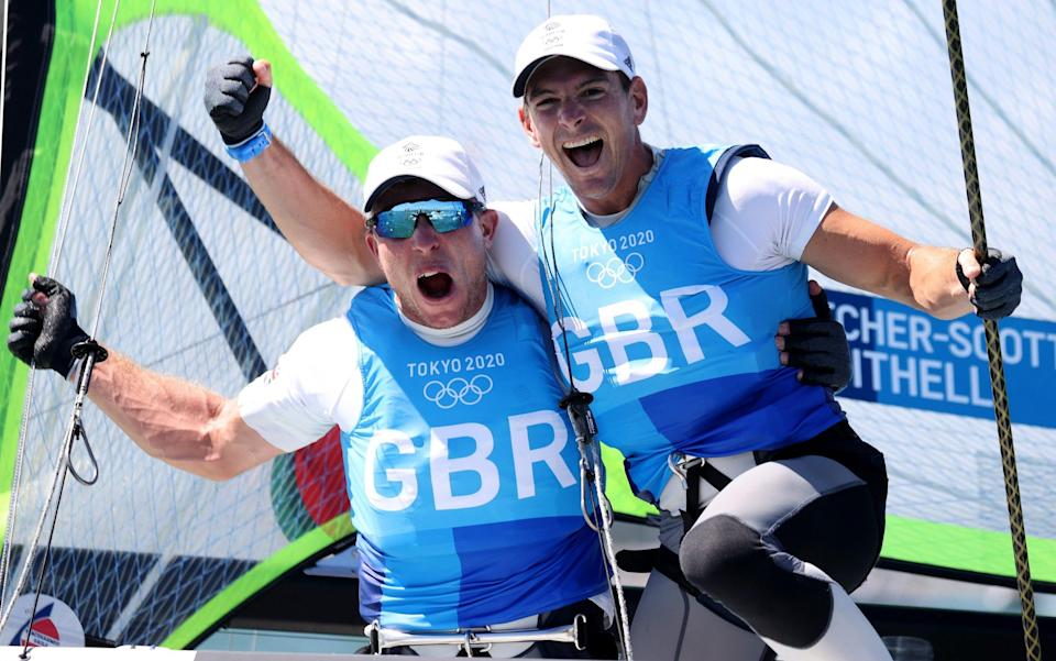 Dylan Fletcher (R) and Stuart Bithell of Team Great Britain celebrate as they win gold in the Men's Skiff 49er class - Getty Images