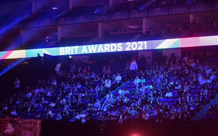 People in the crowd during the Brit Awards 2021 at the O2 Arena, London - Ian West/PA