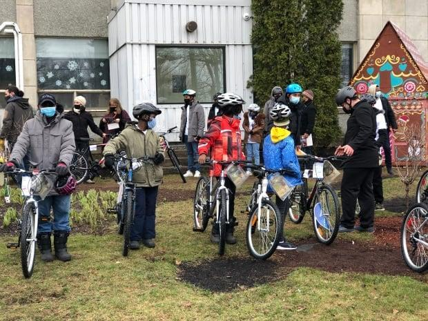 Some newcomers in Fredericton received new bikes on Saturday. (Gary Moore/CBC - image credit)