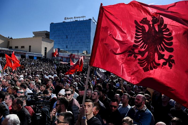 """Rally organisers in Pristina played a video message from ex-prime minister Ramush Haradinaj, who thanked the crowd """"with all his heart"""" while standing in front of an Albanian flag (AFP Photo/Armend NIMANI)"""