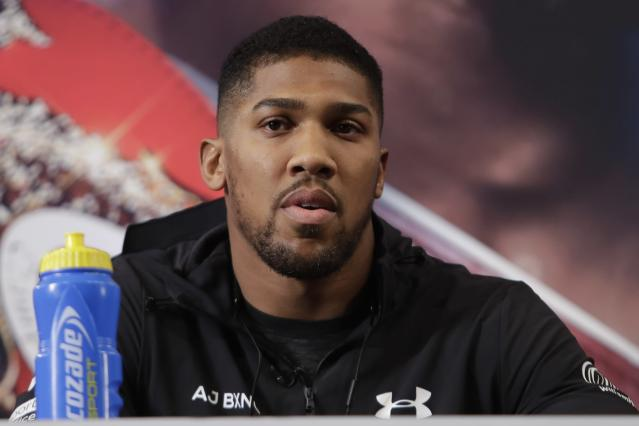 FILE - In this Tuesday, Feb. 19, 2019 file photo, British boxer Anthony Joshua attends a news conference to promote an upcoming fight against Jarrell Miller, in New York. Andy Ruiz Jr. will look to become Mexicos first heavyweight champion after replacing Jarrell Miller as the opponent for unbeaten WBA, IBF and WBO titleholder Anthony Joshua. Miller was withdrawn from the June 1, 2019 fight at Madison Square Garden after alleged doping violations. (AP Photo/Frank Franklin II, file)