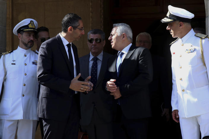 Cyprus' defense Minister Savvas Angelides, second left, talks with his Greek counterpart Evaggelos Apostolakis after their meeting with Cyprus' president Nicos Anastasiades at the presidential palace in Nicosia, Cyprus, Wednesday, May 8, 2019. Cyprus says it will rally support from fellow European Union countries and others to counter Turkey's bid to drill in waters where the east Mediterranean island nation has exclusive economic rights. (AP Photo/Philipps Christou)