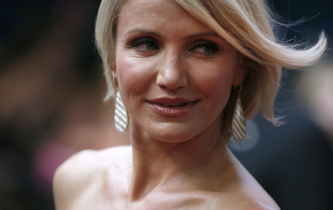 U.S. actress Cameron Diaz poses for photographers as she arrives for the European premiere of the movie 'What to Expect When You're Expecting' at a cinema in London, Tuesday, May 22, 2012. (AP Photo/Matt Dunham)
