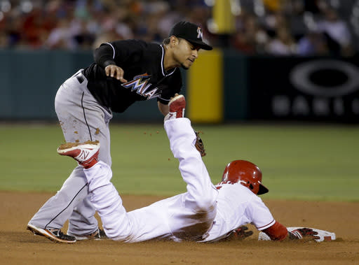 Los Angeles Angels' Erick Aybar, right, is tagged out on a steal attempt, by Miami Marlins second baseman Donovan Solano during the fourth inning of a baseball game in Anaheim, Calif., Tuesday, Aug. 26, 2014. (AP Photo/Chris Carlson)
