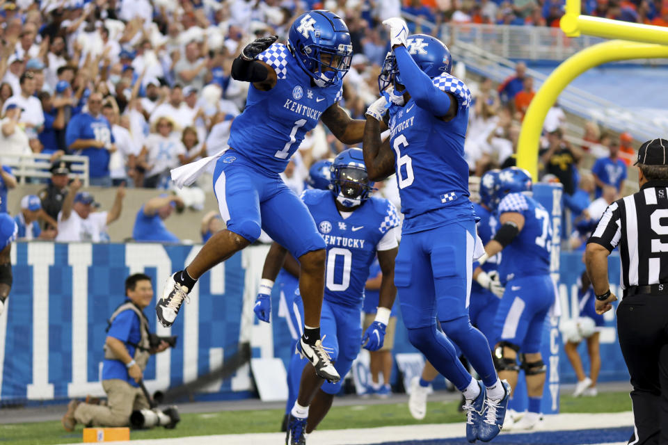 Kentucky wide receiver Wan'Dale Robinson (1) celebrates with wide receiver Josh Ali (6) after making a touchdown during the first half of an NCAA college football game against Florida in Lexington, Ky., Saturday, Oct. 2, 2021. (AP Photo/Michael Clubb)