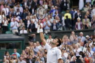 Serbia's Novak Djokovic celebrates after defeating Canada's Denis Shapovalov during the men's singles semifinals match on day eleven of the Wimbledon Tennis Championships in London, Friday, July 9, 2021. (AP Photo/Alberto Pezzali)