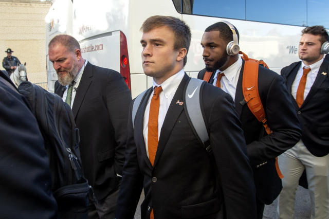 Texas quarterback Sam Ehlinger gets off the bus before an NCAA college football game against Oklahoma at the Cotton Bowl, Saturday, Oct. 12, 2019, in Dallas. (AP Photo/Jeffrey McWhorter)