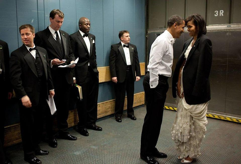 <p>When they stole a private moment in a freight elevator during the Inaugural Ball in 2009 and Barack lent Michelle his blazer. [Photo: The White House/Pete Souza]</p>
