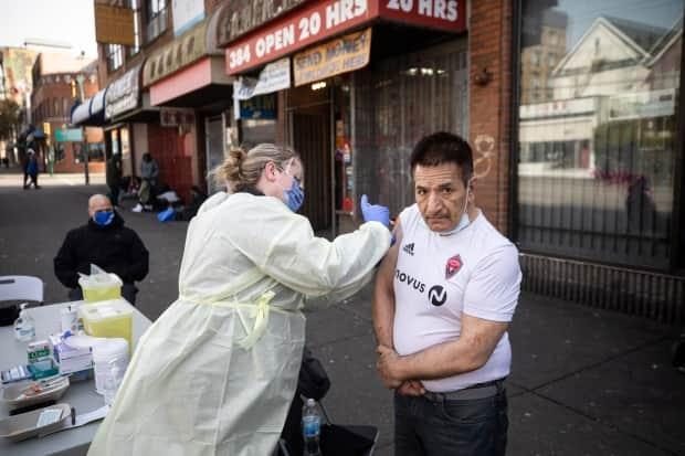 Nurses administer COVID-19 vaccinations to at-risk people in the Downtown Eastside neighbourhood of Vancouver on March 16.