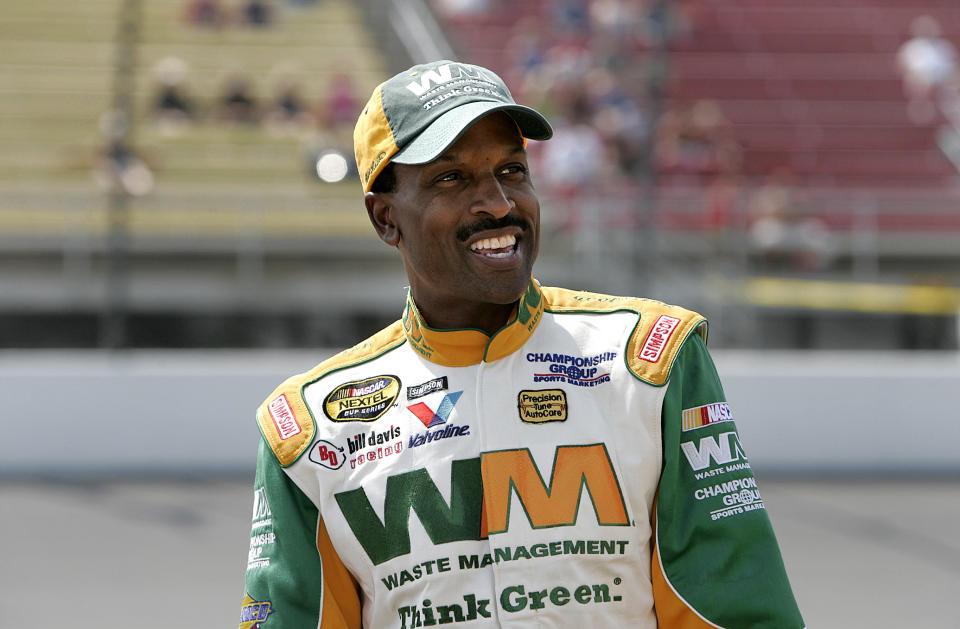 Bill Lester smiles prior to qualifying for the NASCAR Nextel Cup 3M Performance 400 at Michigan International Speedway in Brooklyn, Mich., Friday, June 16, 2006. Lester, the first black driver to race in NASCAR's top stock car series in 20 years, backed up his solid qualifying run in March at Atlanta with another strong performance qualifying 34th. (AP Photo/Paul Sancya)