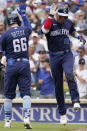 Chicago Cubs' Robinson Chirinos, right, celebrates with Rafael Ortega after hitting a solo home run during the fourth inning of a baseball game against the Arizona Diamondbacks in Chicago, Friday, July 23, 2021. (AP Photo/Nam Y. Huh)