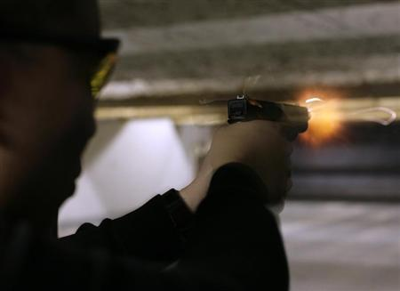 A man fires his Glock pistol at the Maryland Small Arms Range in Upper Marlboro Maryland