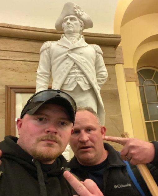 Police officers Jacob Fracker and Thomas Robertson took a selfie inside the U.S. Capitol during an insurrection. (Photo: U.S. District Court)