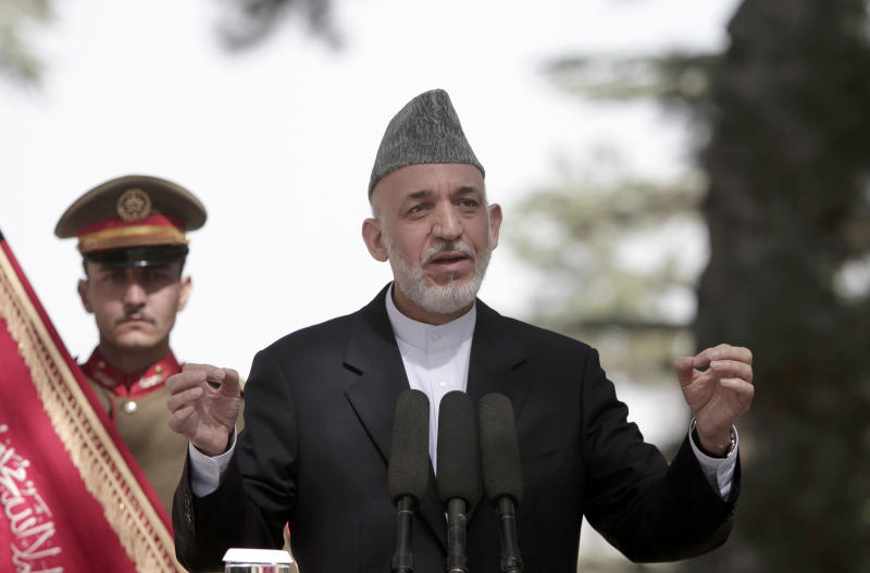 Afghan President Hamid Karzai speaks during a press conference at the presidential palace in Kabul, Afghanistan, Monday, Oct. 7, 2013. Karzai says disagreements over security and sovereignty are impeding a security deal with the United States and says he will convene a council of elders in one month to discuss the agreement. (AP Photo/Rahmat Gul)