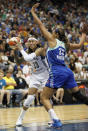 Minnesota Lynx guard Seimone Augustus (33) protects the ball against New York Liberty forward Plenette Pierson (33) in the second half of a WNBA basketball game, Sunday, Aug. 18, 2013, in Minneapolis. The Lynx won 88-57. (AP Photo/Stacy Bengs)