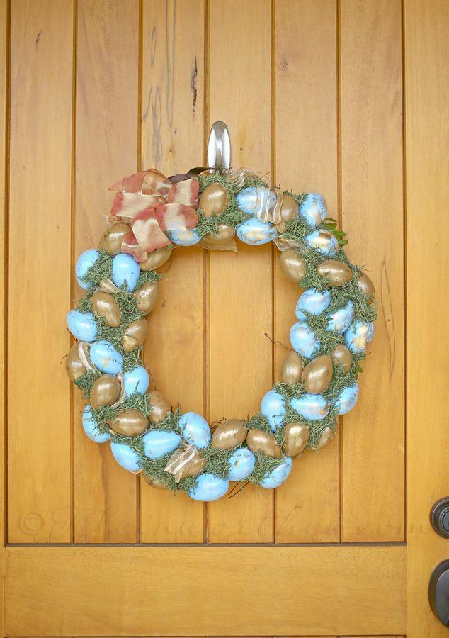"""<p>Let's say that you gravitate toward non-traditional colors for Easter. Instead of light pastels, make this wreath displaying metallic gold and saturated blue eggs. </p><p><strong>Get the tutorial at <a href=""""https://www.kleinworthco.com/blue-gold-easter-wreath/"""" rel=""""nofollow noopener"""" target=""""_blank"""" data-ylk=""""slk:Kleinworth & Co."""" class=""""link rapid-noclick-resp"""">Kleinworth & Co.</a></strong></p><p><a class=""""link rapid-noclick-resp"""" href=""""https://go.redirectingat.com?id=74968X1596630&url=https%3A%2F%2Fwww.walmart.com%2Fip%2FBalsaCircle-50-grams-Green-Natural-Reindeer-Moss-Vase-Fillers-Wedding-Party-Home-Event-Crafts-Centerpieces-Decorations%2F815517642&sref=https%3A%2F%2Fwww.thepioneerwoman.com%2Fhome-lifestyle%2Fcrafts-diy%2Fg35698457%2Fdiy-easter-wreath-ideas%2F"""" rel=""""nofollow noopener"""" target=""""_blank"""" data-ylk=""""slk:SHOP REINDEER MOSS"""">SHOP REINDEER MOSS</a></p>"""