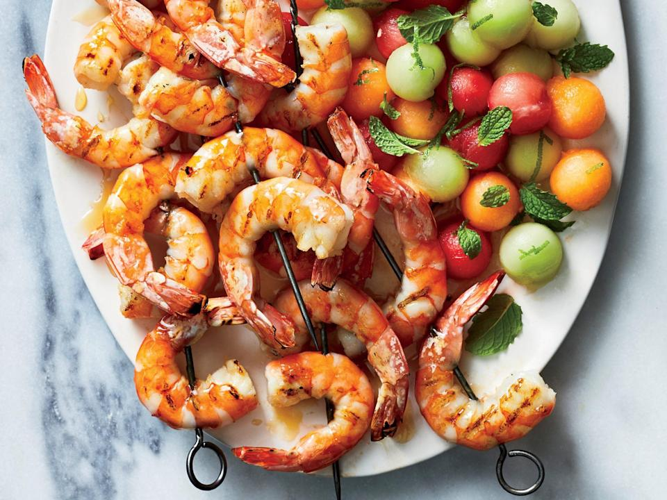 """<p>The <a href=""""https://www.myrecipes.com/shrimp-recipes"""" rel=""""nofollow noopener"""" target=""""_blank"""" data-ylk=""""slk:shrimp"""" class=""""link rapid-noclick-resp"""">shrimp</a> is balanced with slight sweetness, bitter char, and tangy lime-a combination that complements the refreshing melon. Pick the ripest melons you can find; they should be firm but slightly soft and fragrant, especially near the stem end. Round out this dinner with your favorite grain or the <a href=""""https://www.cookinglight.com/recipes/herb-scented-rice-salad"""" rel=""""nofollow noopener"""" target=""""_blank"""" data-ylk=""""slk:Herb-Scented Rice Salad"""" class=""""link rapid-noclick-resp"""">Herb-Scented Rice Salad</a>.</p>"""