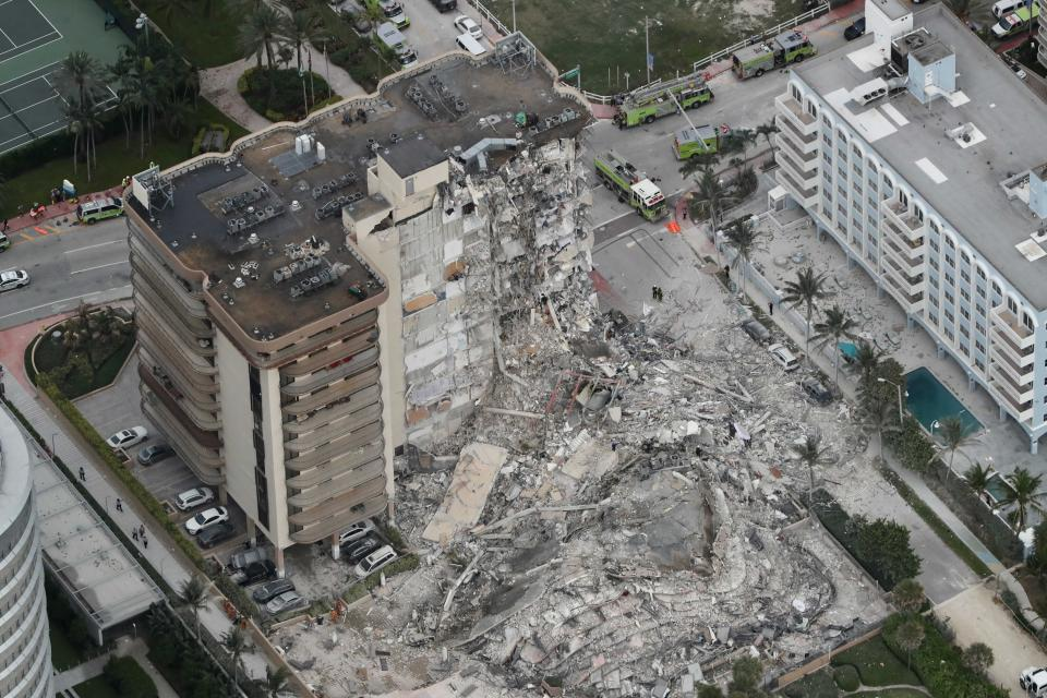 An aerial photo shows part of the 12-story oceanfront condo that collapsed in Surfside, Fla., early Thursday.  (Amy Beth Bennett/South Florida Sun-Sentinel via AP)