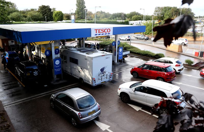 Vehicles queue for fuel at a Tesco petrol station in Stoke-on-Trent