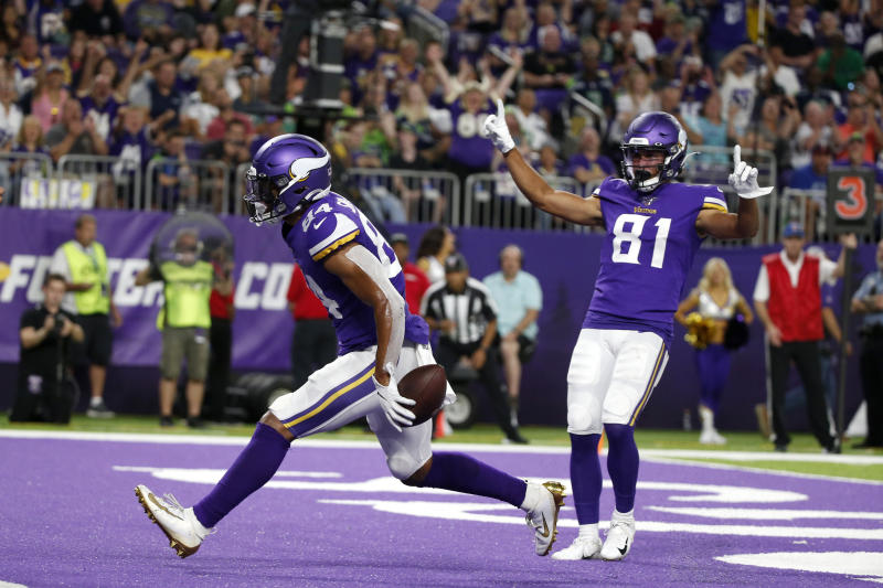 Minnesota Vikings tight end Irv Smith celebrates with teammate Bisi Johnson (81) after catching a 3-yard touchdown pass during the first half of an NFL preseason football game against the Seattle Seahawks, Sunday, Aug. 18, 2019, in Minneapolis. (AP Photo/Bruce Kluckhohn)