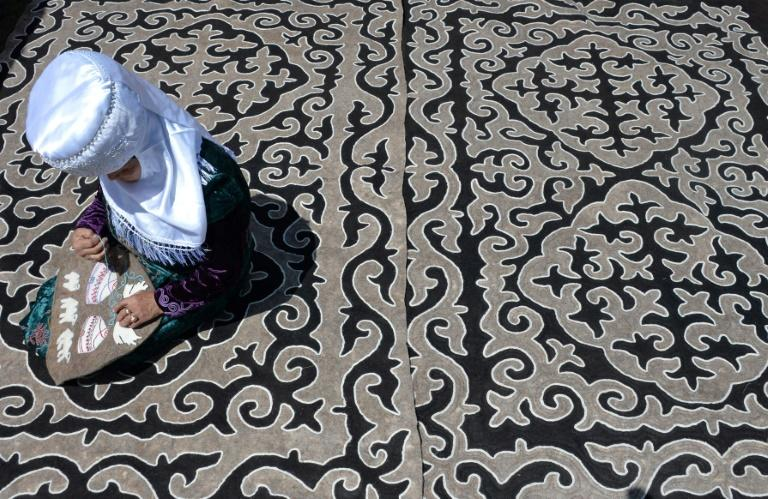Women in Tajikistan's neighbour Kyrgyzstan have been encouraged to wear traditional rather than Islamic dress