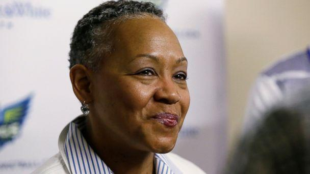 WNBA President Lisa Borders smiles as she speaks to reporters before a WNBA basketball game between the San Antonio Stars and the Dallas Wings in Arlington Texas