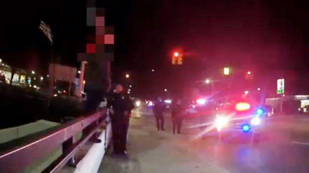 PHOTO: An image made from police body cam footage shows police in Livonia, Mich., taking a distraught man into custody after he threatened to jump off of an overpass, Dec. 17, 2019. (Livonia Police)