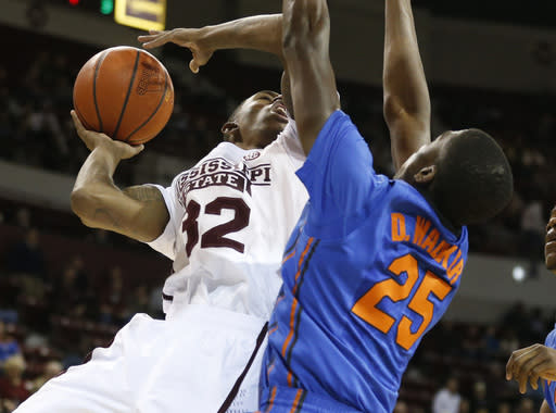 Mississippi State guard Craig Sword (32) tries a layup past Florida guard/forward DeVon Walker (25) in the first half of an NCAA college basketball game in Starkville, Miss., Thursday, Jan. 30, 2014. (AP Photo)
