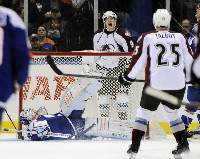 New York Islanders goalie Evgeni Nabokov lays on the ice as Colorado Avalanche's Matt Duchene (9) celebrates his goal in the second period of an NHL hockey game on Saturday, Feb. 8, 2014, in Uniondale, N.Y. (AP Photo/Kathy Kmonicek)